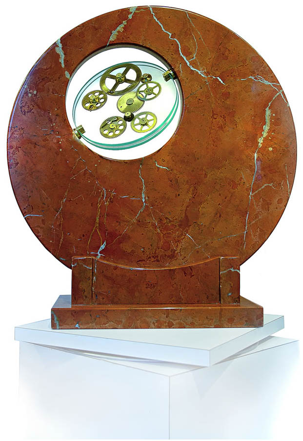 Sculpture Artist Andrea Davide created this kinetic gear art, stone sculpture,